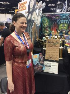 1-Jen Brinkman and her 1st printing of DCC RPG at Gen Con 2017