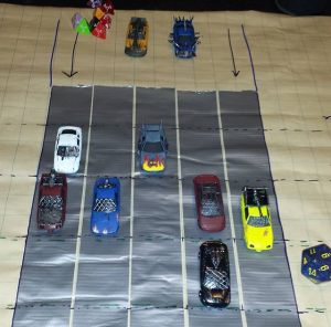 A disposable playmat with duct tape lanes is perfect to track the action