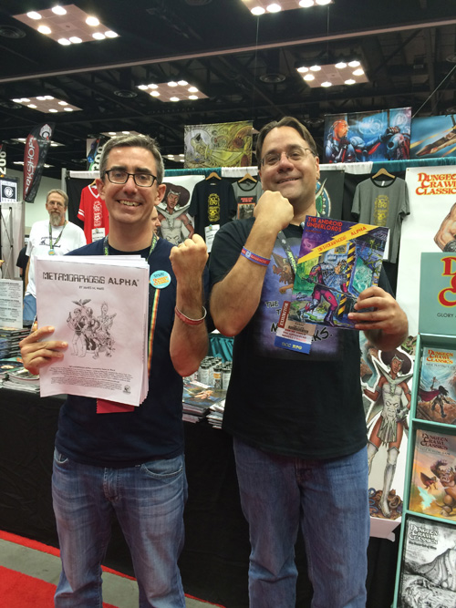Joseph Goodman and Michael Curtis demonstrate the wrist bands at Gen Con 2014