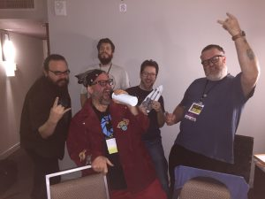 A playtest session at Big Bad Con 2016. The band called themselves BloodBath & Beyond, and their members included Godd Todd on vocal (Todd Evans), Mercurio on double-necked guitar (Jim Dovey), Helmut on bass guitar (Peter Ciccolo), Spider on drums (Mark Malone), and Gogrgor on gong and triangle (Thom Hall).